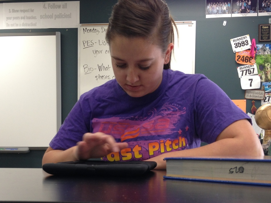High school sophomore Jessica Miller watches her chemistry teacher's lectures on an iPad. Class time is used for working through problems and quizzes, rather than lecturing.
