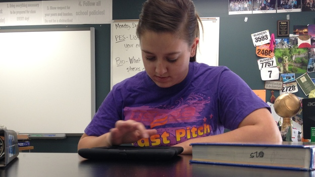High school sophomore Jessica Miller watches her chemistry teacher's lectures on an iPad. Class time is used for working through problems and quizzes, rather than lecturing. (KUNC)
