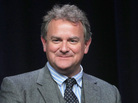Actor Hugh Bonneville speaks onstage in Beverly Hills, Calif., in July 2012.
