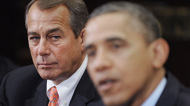 Speaker of the House John Boehner listens as President Obama speaks during a meeting with bipartisan group of congressional leaders in November. (Getty Images)