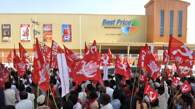 Indian leftist activists rally in front of a Best Price store, owned by Wal-Mart and its Indian partner, Bharti, in Hyderabad in November. The rally was organized to protest foreign direct investment in India's retail sector. (AFP/Getty Images)