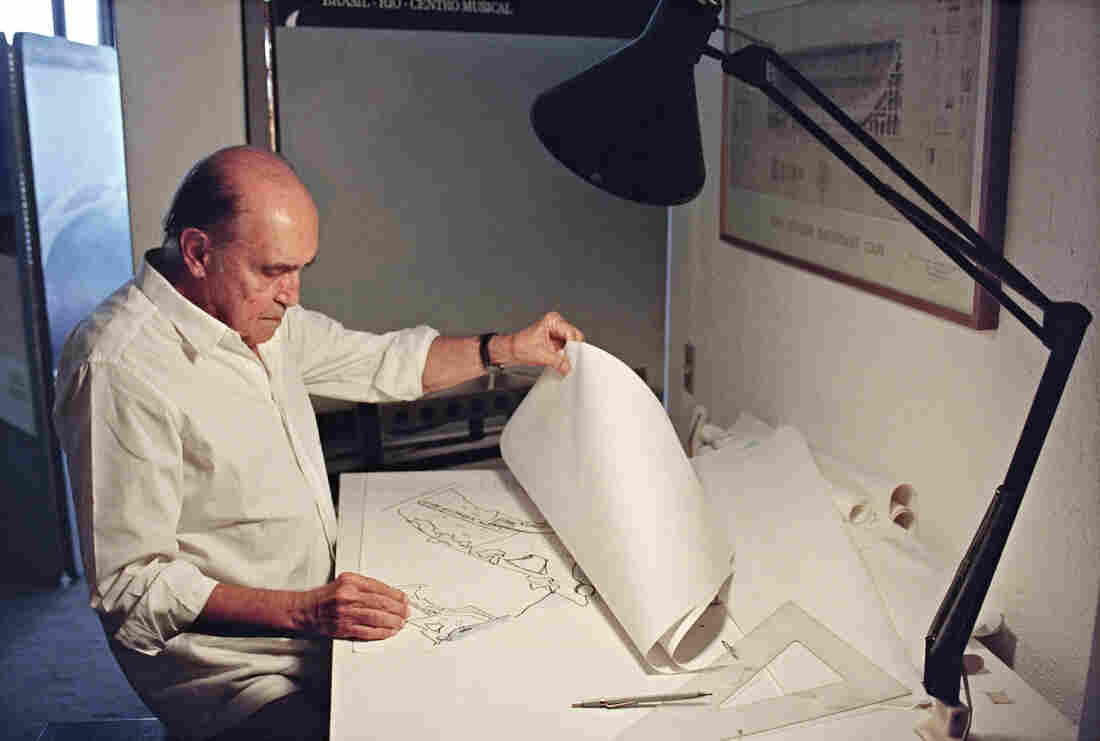 Brazilian architect Oscar Niemeyer looks at drawings for a project of two cities in Senegal, Africa, in his office in Rio de Janeiro, 1992.