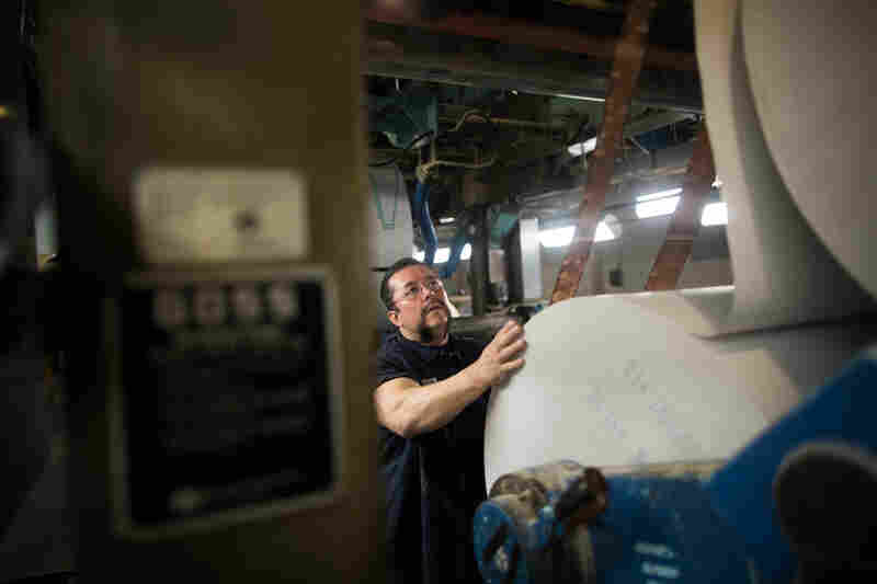 Jerry Ascencio, a pressman at The Orange County Register, works in the basement of the presses.