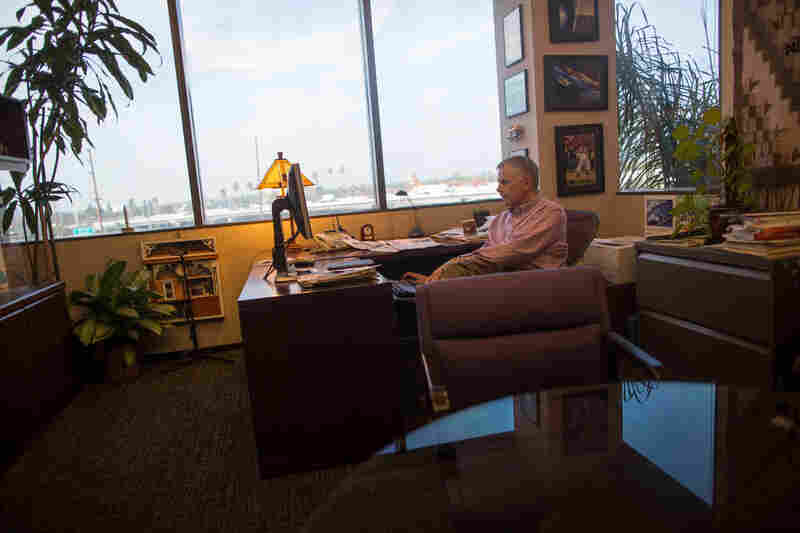 Ken Brusic, senior vice president for content, works in his office overlooking the 5 Freeway. In the past few weeks, Brusic has hired some two-dozen newsroom positions.