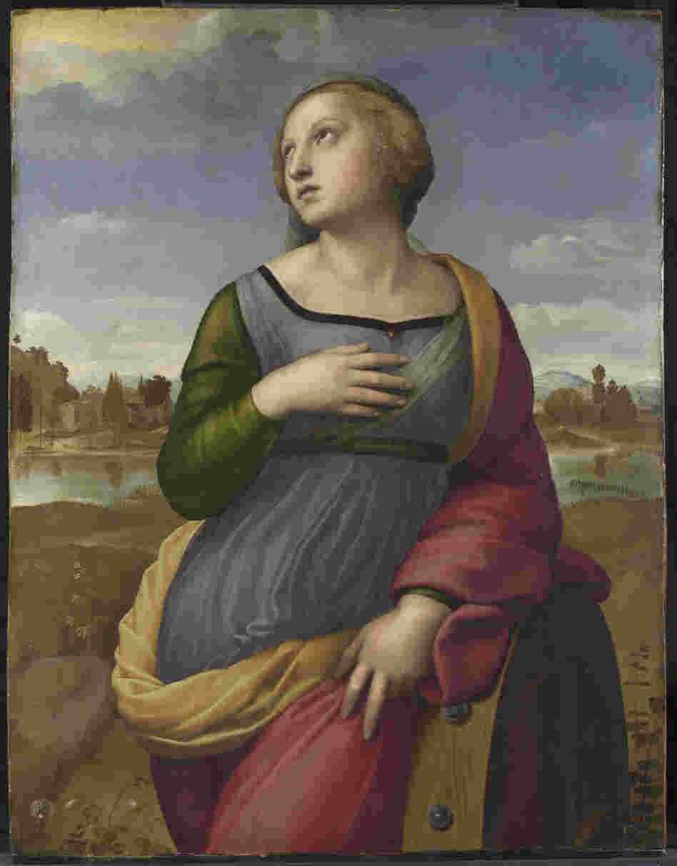 "Raphael's Saint Catherine of Alexandria, circa 1507. NGA curator David Brown says, ""His depiction adopts Catherine's traditional attribute — the wheel that broke during her martyrdom — but instead of stressing the horrific aspect of the event, Raphael has her leaning on the broken wheel in a relaxed classical pose."""