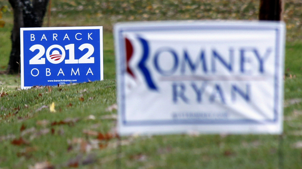 Competing yard signs near Evans City, Pa., four days before the election. The campaigns of President Obama and Republican Mitt Romney each raised more than $1 billion during the race. (AP)
