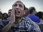 An Egyptian protester chants anti-Muslim Brotherhood slogans during a demonstration in front of the presidential palace in Cairo on Friday.