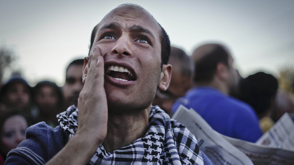 An Egyptian protester chants anti-Muslim Brotherhood slogans during a demonstration in front of the presidential palace in Cairo on Friday. (AP)