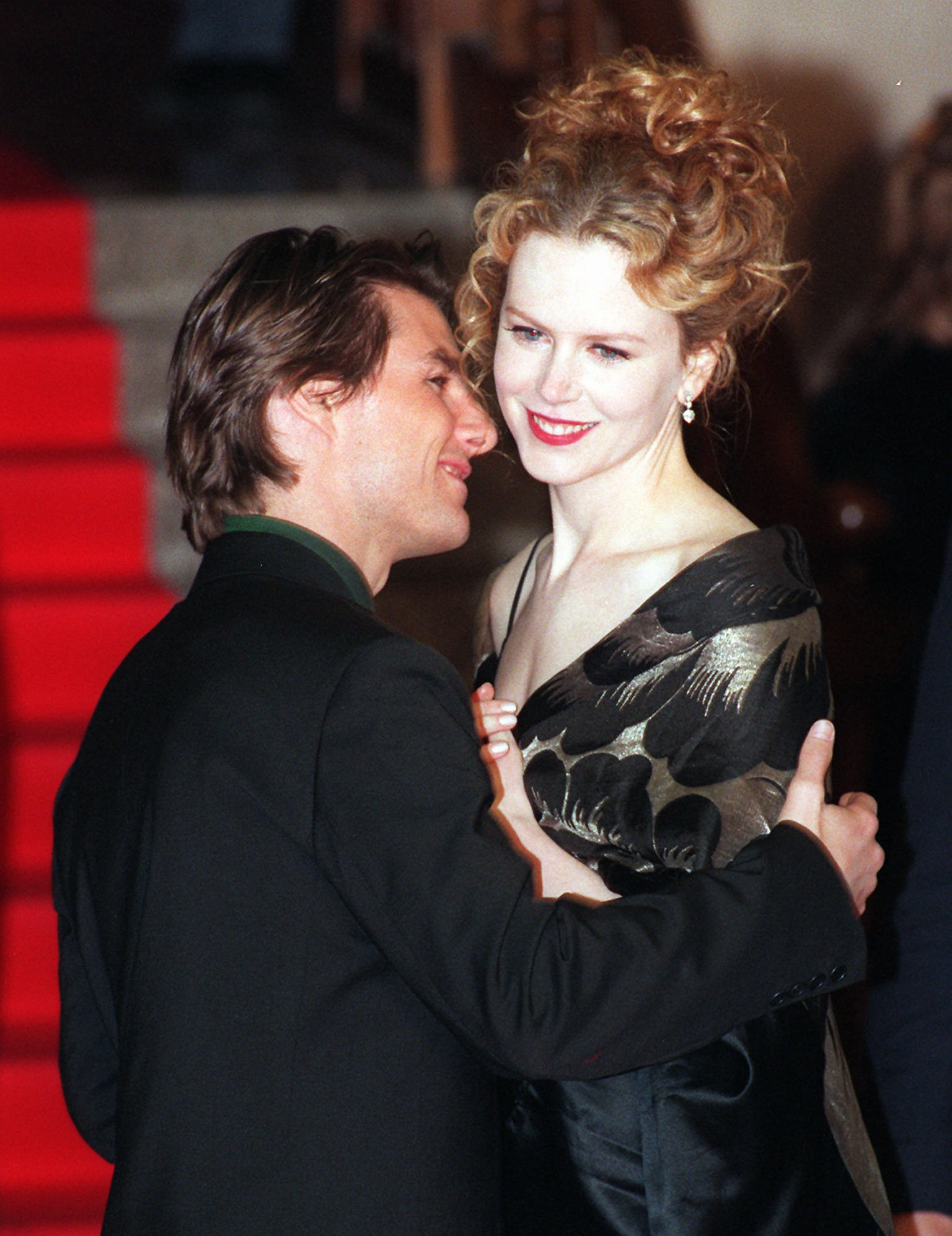 Cruise and his then- wife Nicole Kidman pose for photographers as they arrive at the Italian premiere of his movie Jerry Maguire in 1997.