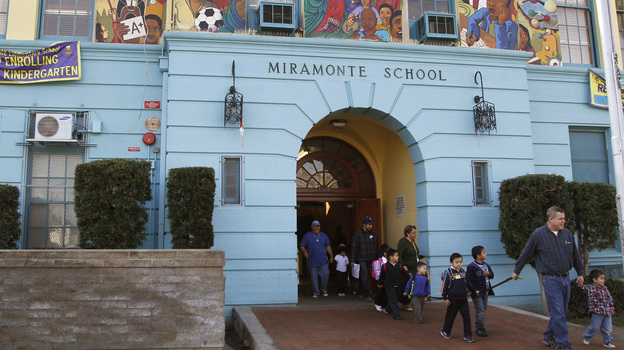 Students leave Miramonte Elementary, in the Clovis Unified School District in Los Angeles. School districts across California have taken out loans requiring payments that far exceed the original loan amounts. (AP)