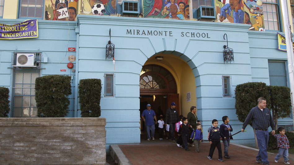 Students leave Miramonte Elementary, in the Clovis Unified School District in Los Angeles. School districts across California have taken out loans requiring payments that far exceed the original loan amounts.