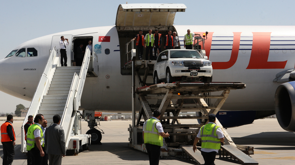 Syrian rebels say they now consider the Damascus International Airport to be part of the battle zone in their fight against Syria's government. Here, a U.N. vehicle is unloaded at the airport on May 12. (AFP/Getty Images)