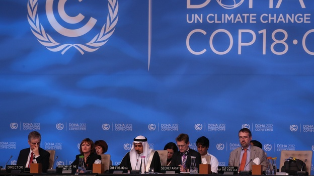 Delegates attend the last day of the U.N. climate talks in Doha, Qatar, on Friday. U.N. climate negotiators locked horns on the final day of talks in Doha to halt the march of global warming, deeply divided on extending the greenhouse gas-curbing Kyoto Protocol and funding for poor countries. (AFP/Getty Images)