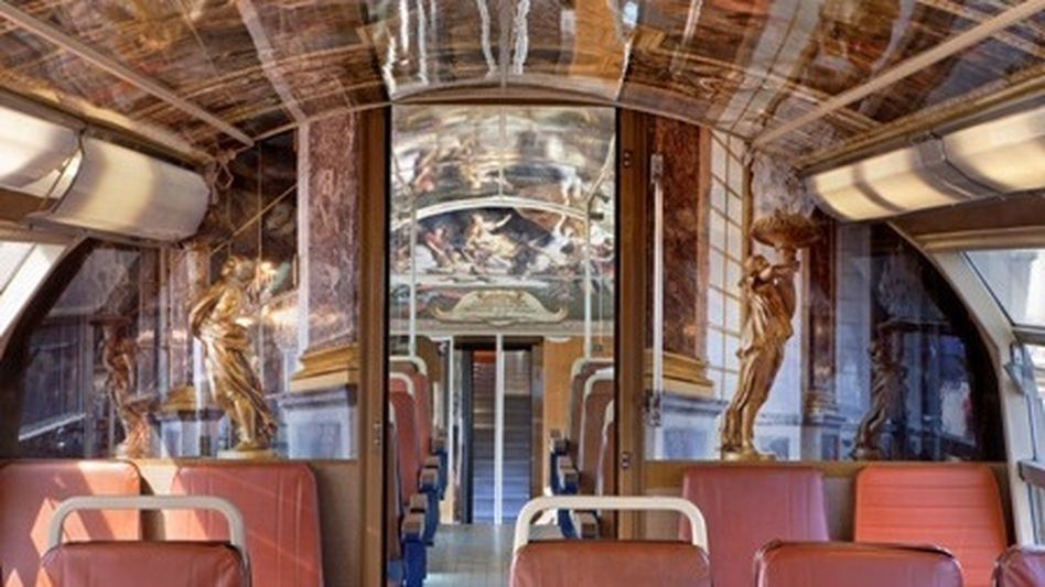 The cars of about 30 trains traveling between Paris and the Palace of Versailles are decorated to reflect rooms and other areas at the famous royal chateau and former seat of French power. Here, the famed Hall of Mirrors. (Courtesy of Christian Recoura)