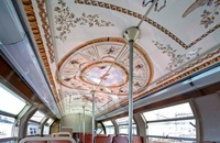 Each train's seven cars are decorated using sticker-like coverings made of a plastified film to reflect rooms or areas of Versailles.