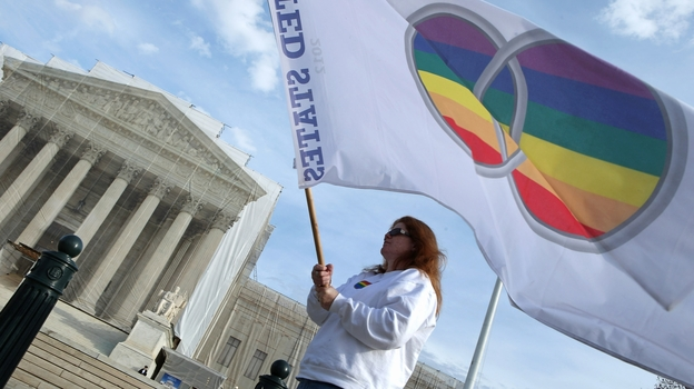 Same-sex marriage proponent Kat McGuckin of Oaklyn, N.J., holds a gay marriage pride flag in front of the Supreme Court Nov. 30, 2012. The court says it will review two cases related to same-sex marriage in 2013. (Getty Images)