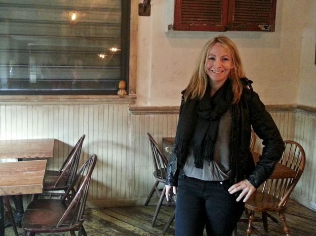 Jenny Adams in the Wayland Bar in Alphabet City, where she stored piles of relief supplies to distribute. Adams raised $10,000 through a crowdfunding website to help her neighbors affected by Hurricane Sandy.