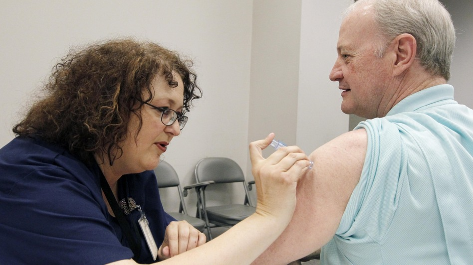 Bill Staples, a Mississippi health department worker, gets a flu shot in October. Mississippi is one of eight states where flu is already widespread this season. (AP)