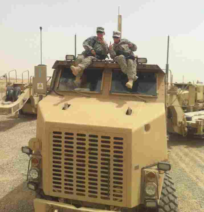 The mother-daughter duo on one of the trucks they drove in Iraq in Camp Speicher, Tikrit, Iraq.