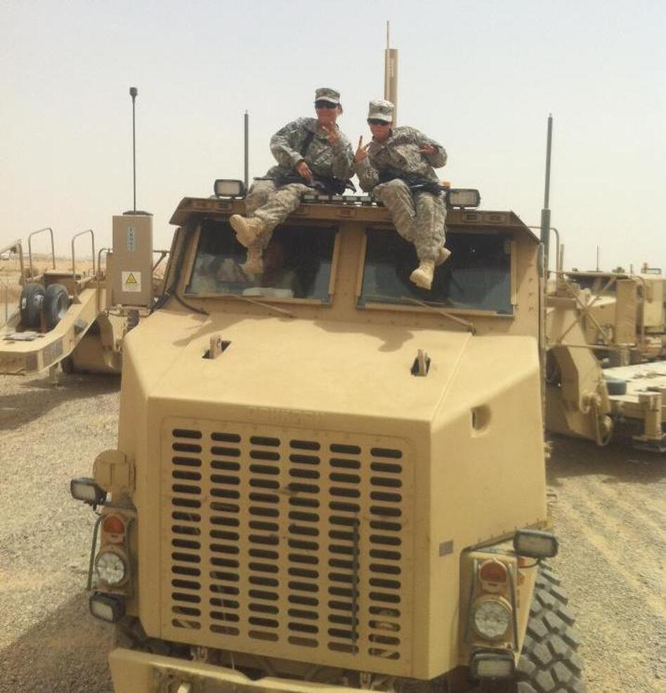 The mother-daughter duo on one of the trucks they drove in Iraq in Camp Speicher, Tikrit, Iraq. (Courtesy of Jessica Pedraza)