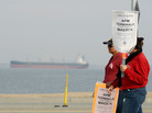 An empty container ship waited near the Port of Los Angeles during the eight-day strike by members of the International Longshore and Warehouse Union. The stoppage put a halt to most of the work at the Los Angeles and Long Beach ports.