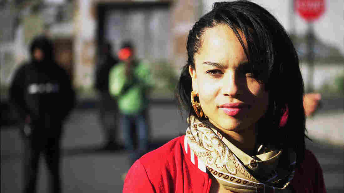 Without a supportive family, a rebellious teenager (Zoe Kravitz) must take care of herself in a troubled neighborhood.