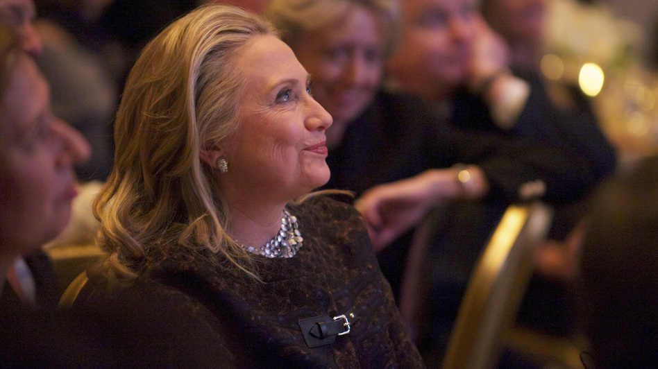 Secretary of State Hillary Clinton watches a video about her public life that was played before she addressed the Saban Forum in Washington last week. (Reuters /Landov)
