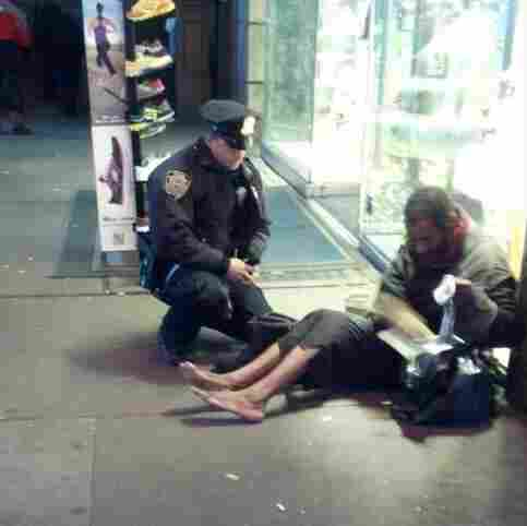 The photo that touched many hearts: New York City Police Officer Lawrence DePrimo gives a shoeless man a pair of boots on a frigid night last month.