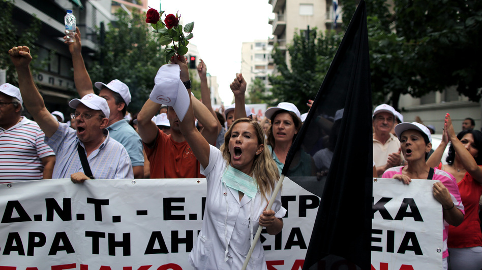 Public hospital workers protest outside the Health Ministry in central Athens in October. Hospital budgets have been slashed by more than half. (AP)