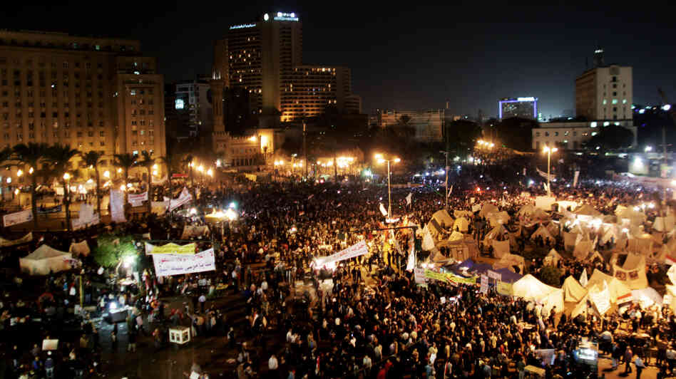 Protesters gather in Tahrir Square in Cairo, Egypt, on Tuesday. Tens of thousands of Egyptians also gathered outside the presidential palace in Cairo in demonstrations that turned vi