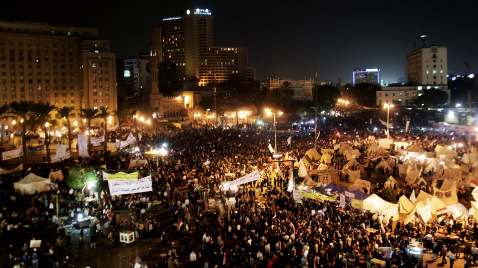 Protesters gather in Tahrir Square in Cairo, Egypt, on Tuesday. Tens of thousands of Egyptians also gathered outside the presidential palace in Cairo in demonstrations that turned violent as tensions grew over President Mohammed Morsi's seizure of nearly unrestricted powers. (AP)
