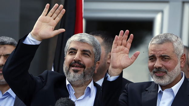 Exiled Hamas chief Khaled Mashaal (left) and Gaza's Hamas Prime Minister Ismail Haniyeh wave during a news conference upon Meshaal's arrival at Rafah crossing in the southern Gaza Strip on Friday. (AP)
