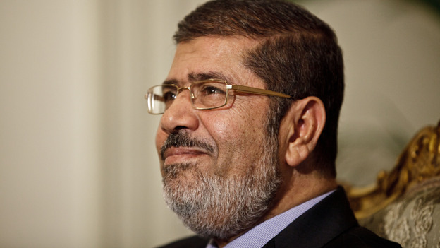 """Egyptian President Mohammed Morsi held a """"dialogue"""" in Cairo on Saturday. Overnight, an official announced the president would nullify a decree that gave him expanded powers. (AP)"""