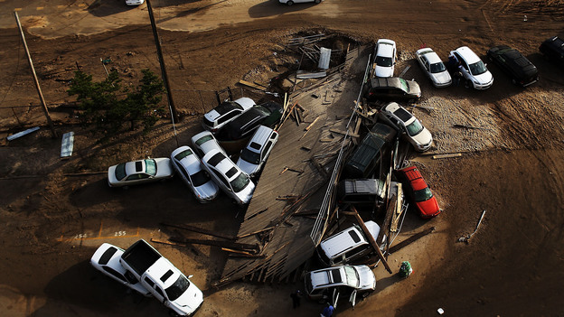 Abandoned and flooded cars sit in the Rockaway neighborhood of Queens, N.Y., on Nov. 2. It's estimated that it could cost auto insurers $800 million to deal with all the claims from the storm. (Getty Images)