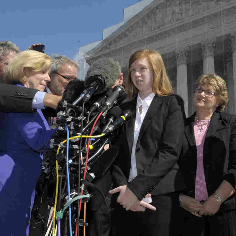 Abigail Fisher, the Texan involved in the University of Texas affirmative action case, accompanied by her attorney Bert Rein, right, talks to reporters outside the Supreme Court in October.