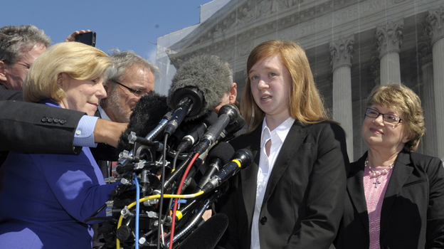 Abigail Fisher, the Texan involved in the University of Texas affirmative action case, accompanied by her attorney Bert Rein, right, talks to reporters outside the Supreme Court in October. (AP)