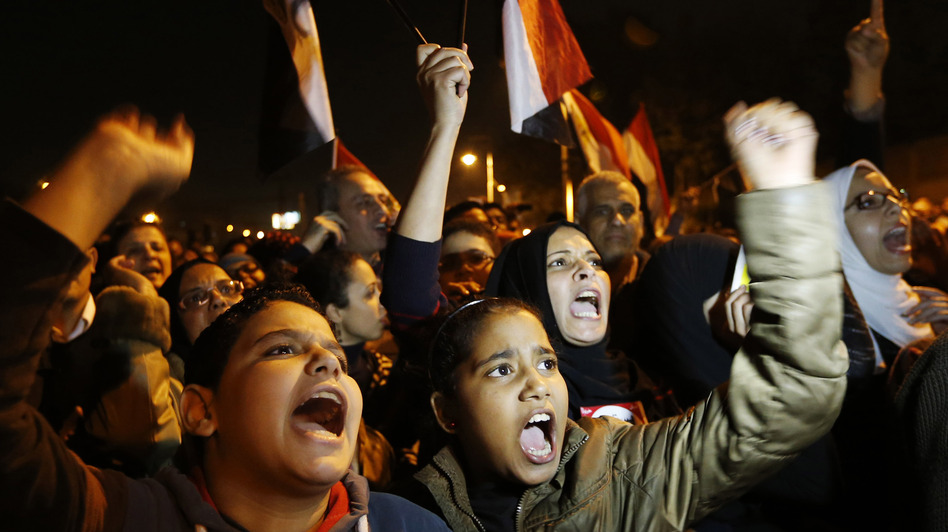 Protesters chant slogans during a demonstration in front of the presidential palace in Cairo, Egypt, on Sunday. (AP)