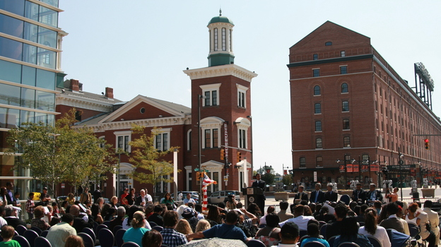 Hundreds gather in Baltimore's harbor Sept. 22 to witness the naturalization of nearly 50 new Americans. (NPR)