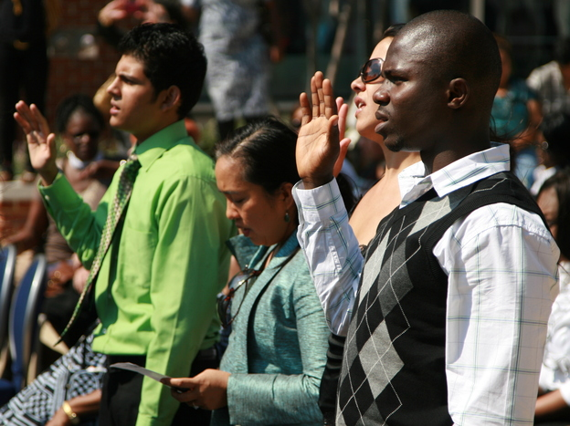 Nearly 50 immigrants took the U.S. naturalization oath at the Baltimore harbor on Sept. 22.