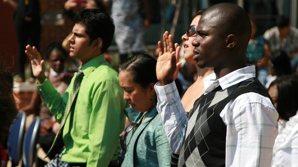 Nearly 50 immigrants took the U.S. naturalization oath at the Baltimore harbor on Sept. 22. (NPR)