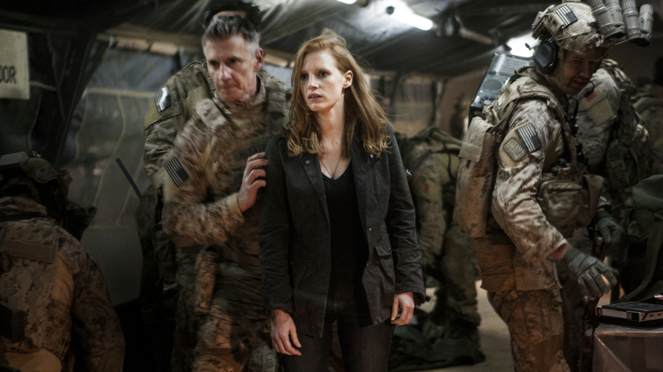 Stationed at a covert base overseas, Maya (Jessica Chastain) is a member of the elite team of spies and military operatives (Christopher Stanley, left, and Alex Corbet Burcher, right) who devote themselves to finding Osama bin Laden. (Sony Pictures)