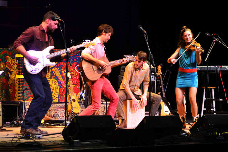 The full band, including bassist Greg Glassman and drummer Philip Mayer.