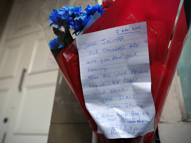Flowers and a note outside the apartments near King Edward VII Hospital in