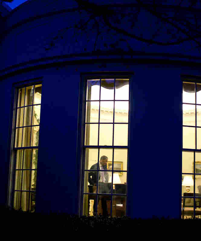 """President Obama in the Oval Office, where there may be some more late night bargaining sessions before a deal is reached to keep the federal government from going over the """"fiscal cliff."""" (December 2009 file photo.)"""
