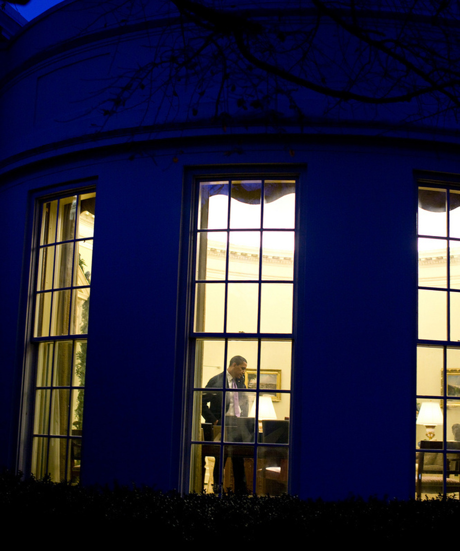 "President Obama in the Oval Office, where there may be some more late night bargaining sessions before a deal is reached to keep the federal government from going over the ""fiscal cliff."" (December 2009 file photo.)"