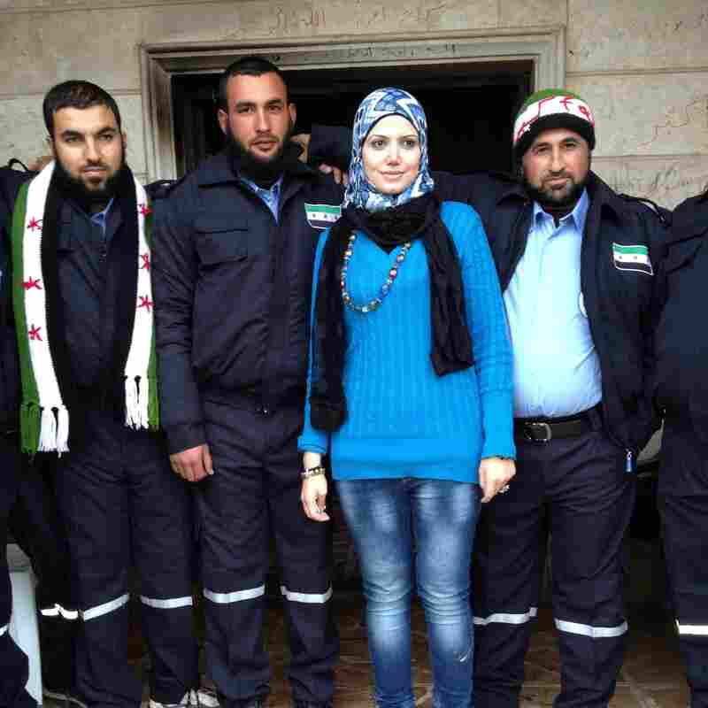 Razan Shalab Alsham, in bright blue, works for the Syrian Emergency Task Force. She helped provide uniforms for the  new civil police force of Khirbet al-Joz.