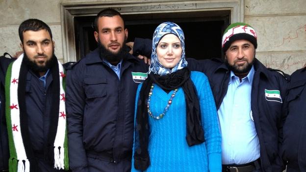 Razan Shalab Alsham, in bright blue, works for the Syrian Emergency Task Force. She helped provide uniforms for the  new civil police force of Khirbet al-Joz. (Deborah Amos)