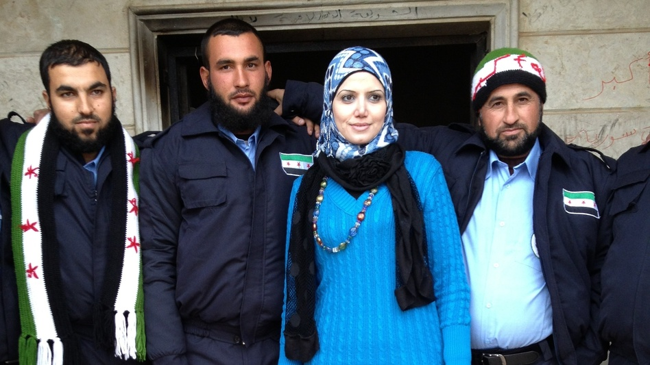 Razan Shalab Alsham, in bright blue, works for the Syrian Emergency Task Force. She helped provide uniforms for the  new civil police force of Khirbet al-Joz. (Deborah Amos)