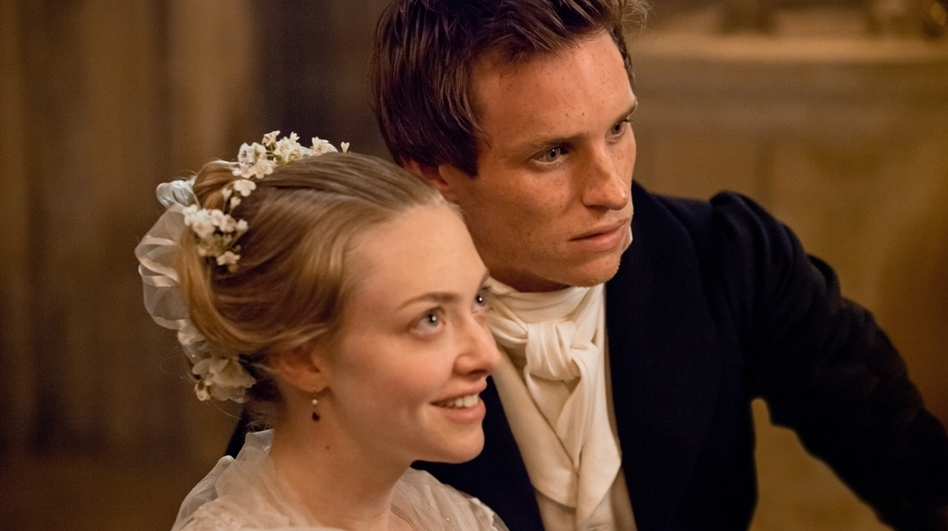 Cosette (Amanda Seyfried) and Marius (Eddie Redmayne) fall in love in a world shaken by revolution. (Universal Pictures)