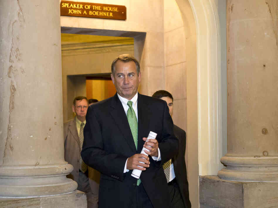 Speaker John Boehner leaves his office Tuesday and walks to the House floor to deliver remarks about negotiations with President Obama on the fiscal cliff.